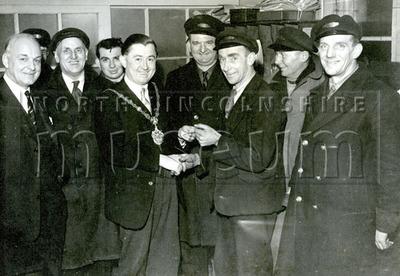 Mayor Gerard McQuade meeting a group of unknown gentlemen, c.1957-1958.