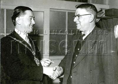 Mayor Gerard McQuade meeting an unknown gentleman, c.1957-1958.