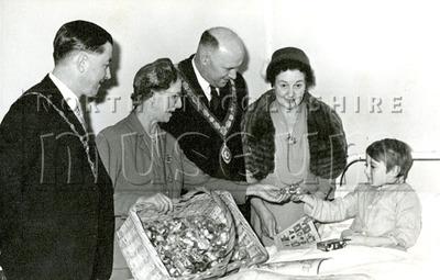 Mayor Gerard McQuade and Mayoress Catheirine McQuade handing out toys to sick children, c.1957-1958.