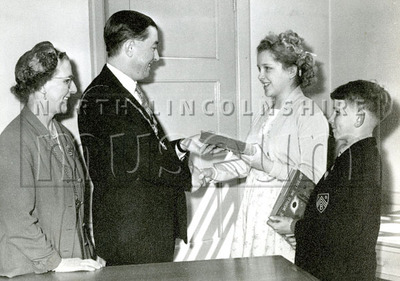 Mayor Gerard McQuade and Mayoress Catherine McQuade presenting books to children, c.1957-1958.