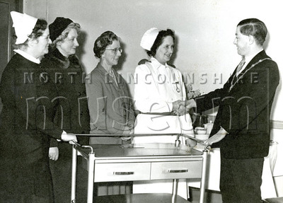 Mayor Gerard McQuade meeting nurses at a local hospital, c.1957-1958.