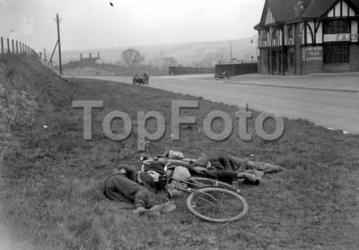 Cyclist sleeping on the roadside 1934