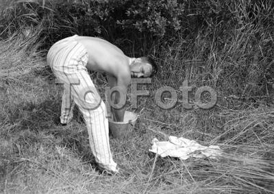 Man washing, Norfolk Broads. 1934