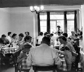 August bank holiday scramble 1953  Mr and Mrs Smiths boarding house Margate Holiday makers sit down to a meal.