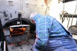 Shoveling coal in the boiler