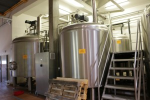 Brewery: pouring malt into a mash tun (3)