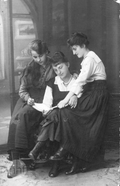 Group portrait of three young women.