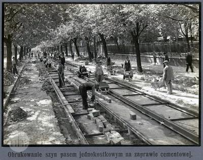Building the tram line. Paving the rails.