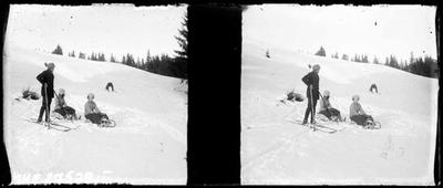 Four people on snowy slope.