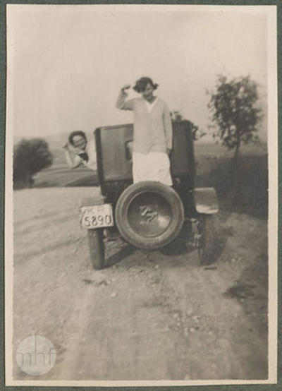 Kosiński sisters by the car on the road, portrait, rural landscape in the background.