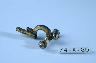 Volledige drieknoppenfibula in verguld brons