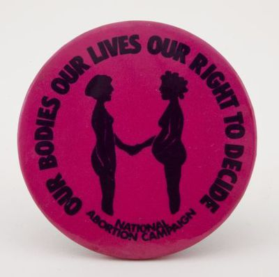 Button. 'Our bodies our lives our right to decide'
