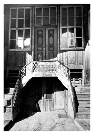 Main entrance of a house with wood carved elements
