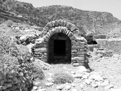 Early Christian barrel-vaulted burial chamber with Christian dipinti on the inside wall; Palatia, Saria island, Dodecanese.