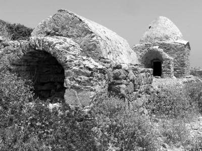 Two types (acute arched and beehive) of burial chambers of the Roman/Early Christian necropolis of Palatia site, Saria islet (Dodecanese)