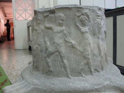 Cylindrical altar-like marble base with relief decoration of Dionysaic themes, from Milos island, 4th century