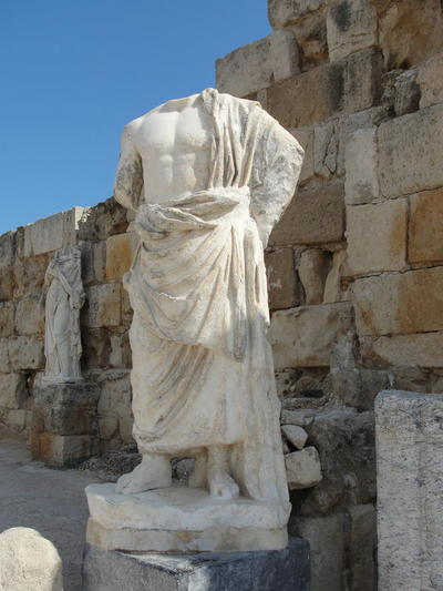 Marble statue of a male notable on an inscribed base, East Stoa of the Gymnasium/Bath complex of ancient Salamis, Cyprus