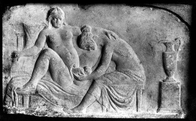 Ancient Roman relief carving of a midwife attending a woman giving birth.