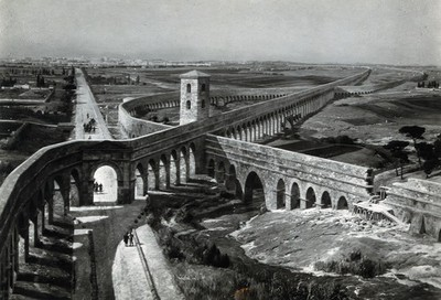 Roman aqueducts in Via Latina, to the southeast of Rome: view of the crossing of two aqueducts during ancient Roman times, with the city of Rome seen in the distance. Photograph, ca. 1936, of a painting by M. Zeno Diemer, ca. 1910/1935.