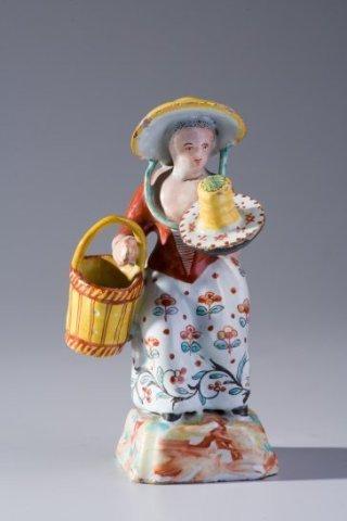 Meisje met hengselmand en schaal met een kluit boter