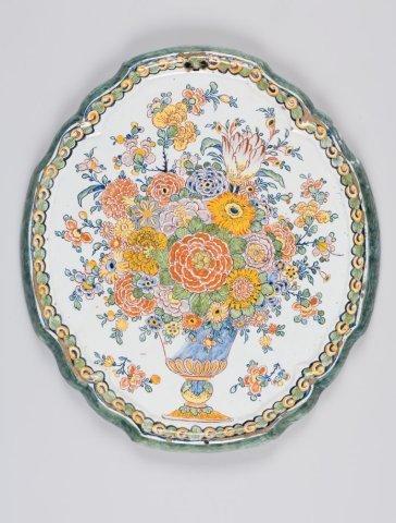 Plaque met decoratie van een bloemenmand