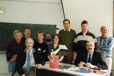 De vakdocenten wiskunde op Scholengemeenschap Spieringshoek in april 1999 in lokaal 10. Vooraan links R.W. Poels, vooraan rechts C.A.N.van Haaster. Achteraan v.l.n.r.:           J.L.H. Meisters, P.J.C.J.van Koppen, A.van Leeuwen, H.M.M. Aernoudts, M.J.de Ridder-de Groote, E.J.M. Clarenbeek (o.s.a.), G.J.M. Jansen, E.W. Boon.
