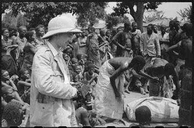 Edmond Séchan holding his camera\, Ouesso (Middle Congo)