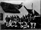 North Devon Cricket Club v Devon Dumplings 1912. Both teams in front of clubhouse.