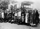 Group in front of bus. Recognised so far: Evelyn Tidball, Mrs Selby, L.T. Price.