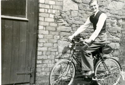 National Childrens Home, Newton.  Old boy, Eric on his bike.