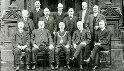The Health Committee of Widnes Corporation sitting outside the front doors of Widnes Town Hall