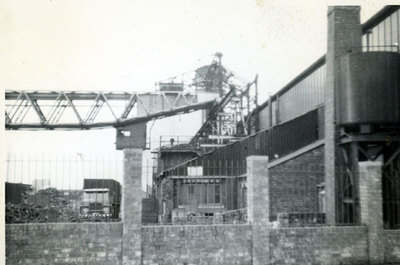 Widnes Foundry showing the large travelling crane which fed the cupolas - melting furnaces. The building on the right is the mould shop. The gas holder on the left of the photo was part of the Widnes