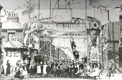 The Triumphal Arch erected at the top of Mersey Road at the junction with Irwell Street, West Bank in June 1902 to celebrate the coronation of King Edward VII. The inscription is written in Welsh due