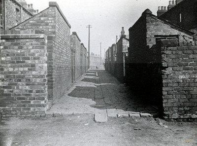 Back alleyway between terraced houses, old Widnes.