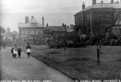 Appleton House and gardens with Angel and Elephant Public House in background.