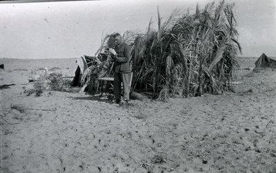 Palm leaf hut in Naghiliat