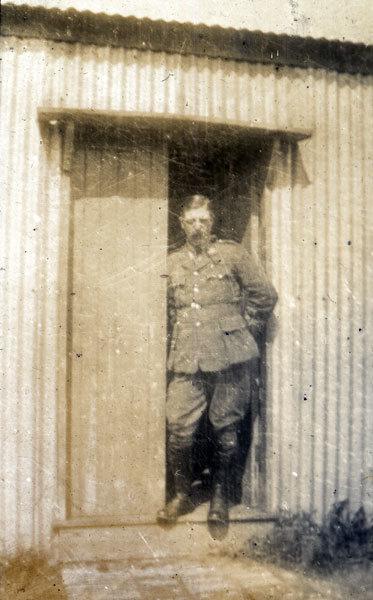 Captain Walker standing in a doorway