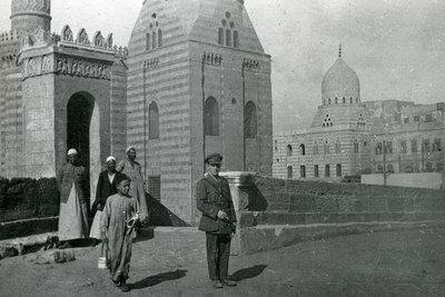 Officer and civilians at entrance to citadel at Cairo