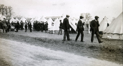 New recruits in civilian dress near tents in Heaton Park