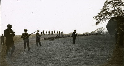 Recruits being taught how to use a rifle.