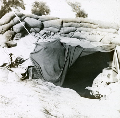 Soldier with a machine gun protected by sandbags