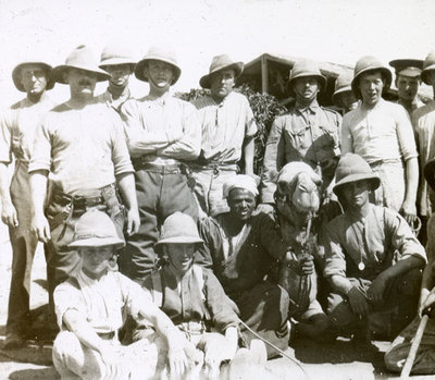 Group of soldiers with local and a camel