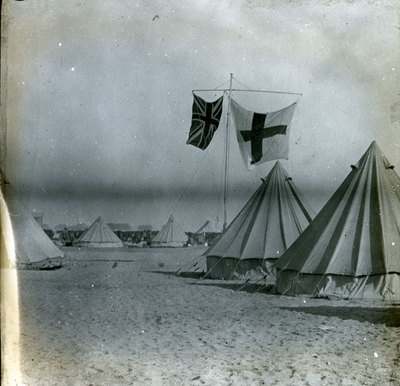 Tents in the desert with Union flag and St Georges flag flying