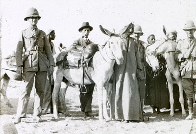 Group of men with donkeys and local men