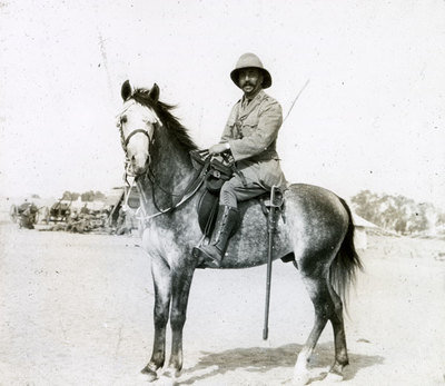 Officer on horseback.