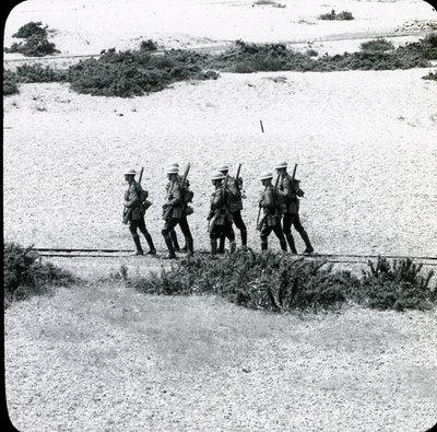 Patrol walking along railway