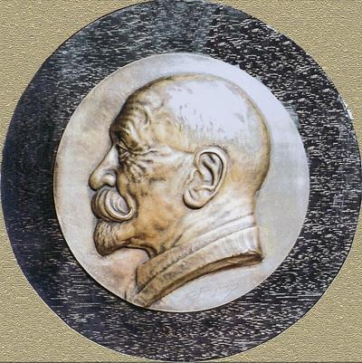 Arkova spominska plakete, delo postojnskega kiparja Ivana Sajevica