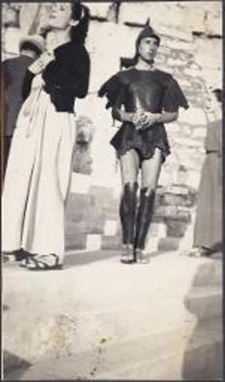 King Paul visits the Acropolis. Entryway with flags of honor. Man and woman in ancient costume.