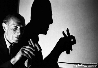 Hands of a shadow puppeteer.