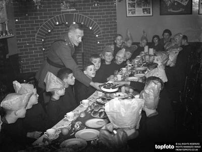 Boys being served their Christmas